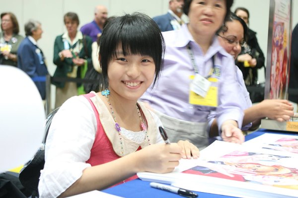 Peace Poster Contest Grand Prize Winner Yu-Min Chen Autographs Posters