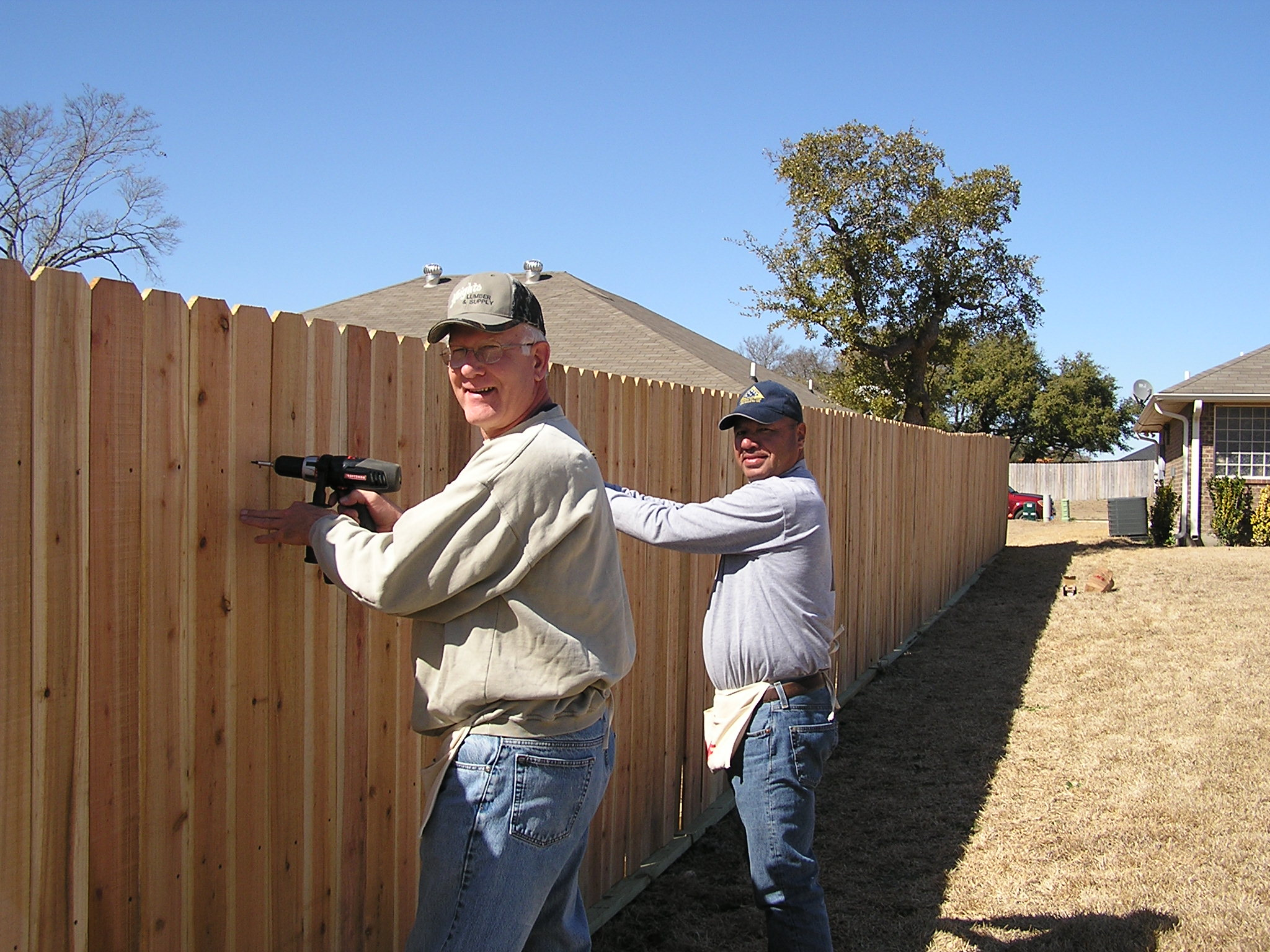 Killeen Noon Lions Club members building a fence for Gerty.